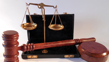 A&A Expert Witness service Chelmsford. Photo of justice scales and gavel.