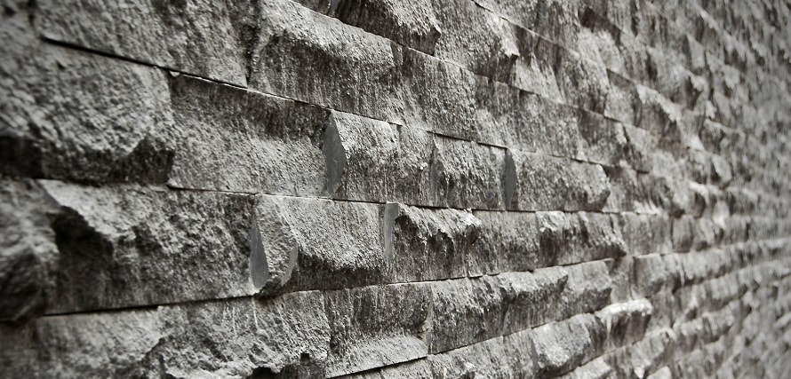 close up of a grey brick wall